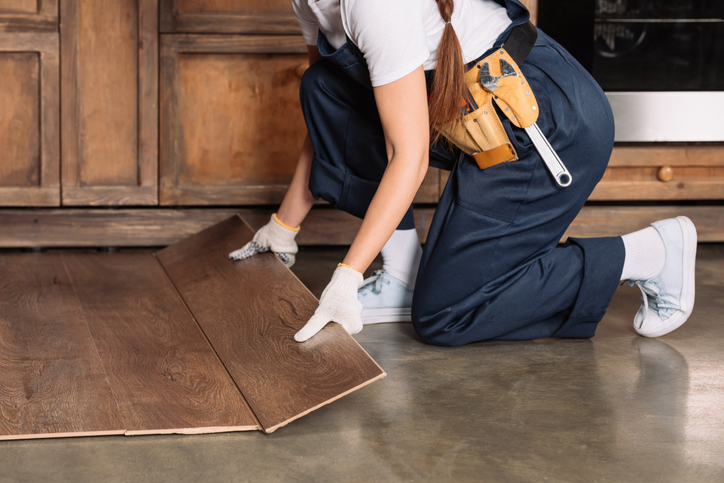Vinyl flooring is the best bet in terms of practicality and price, but you can explore other affordable options such as laminate floorboards and linoleum.