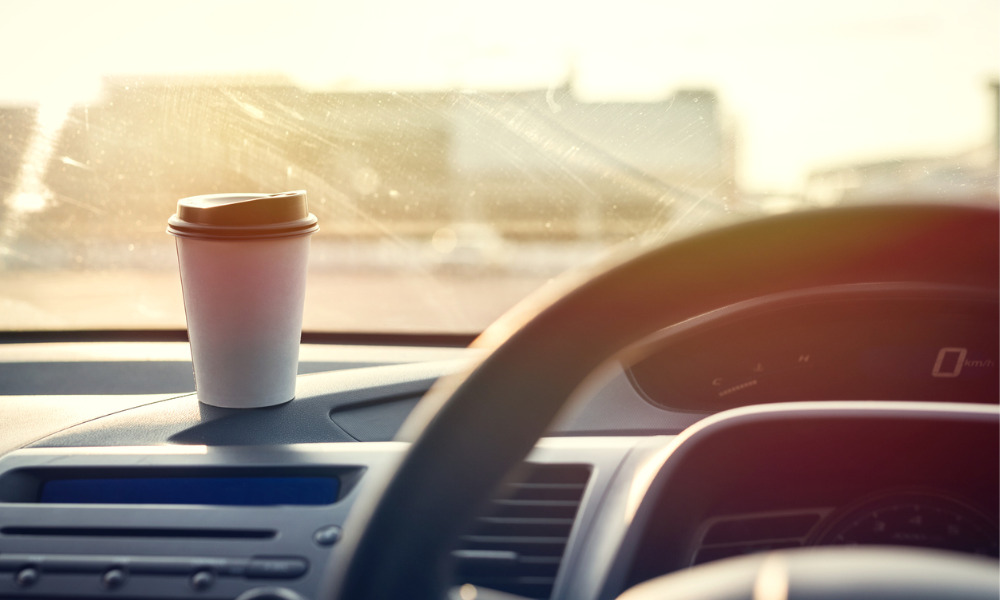 Tribunal finds that spilling tea while stopped at a red light is not an automobile accident