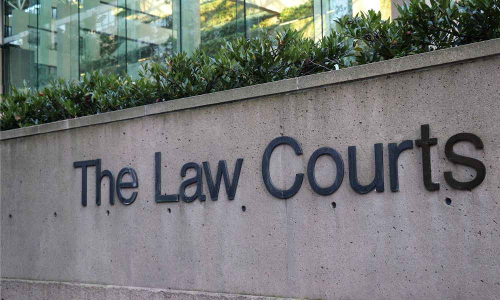Court determines applicable test in suit seeking to release trust fund for payment of legal fees
