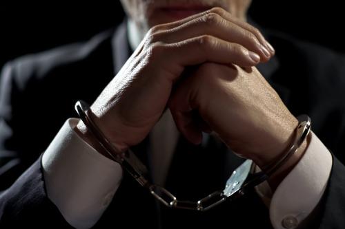 FBI arrests ex-State Farm insurance agent in $60 million bribery case