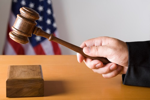 Former California agent pleads guilty to felony grand theft