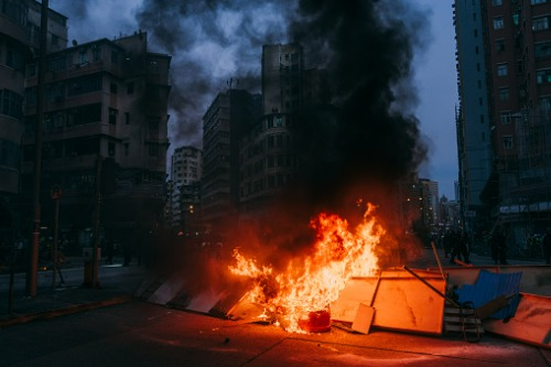 What is behind the increased demand for strikes, riots and civil commotions insurance?