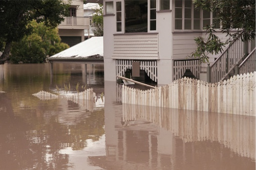 What steps can property owners take to mitigate flood exposure?