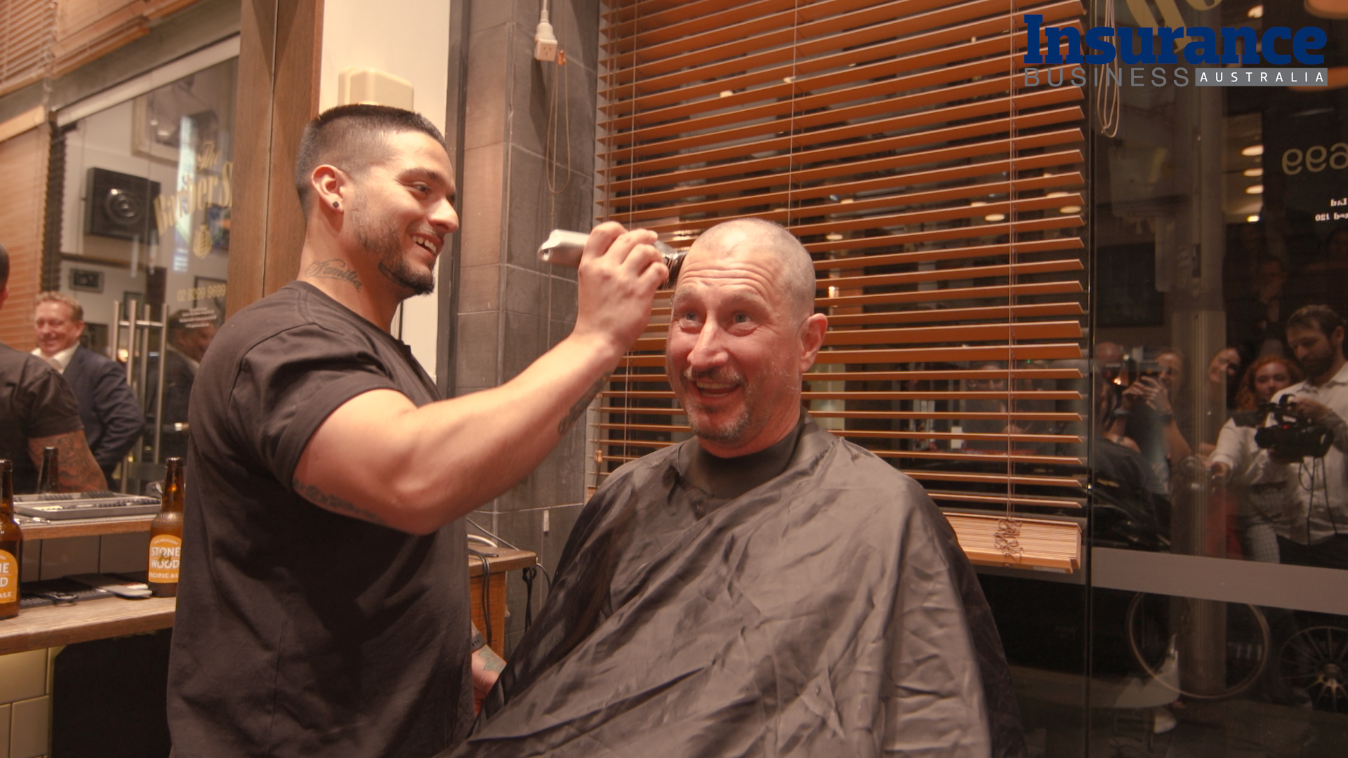 CEO raises $70K with charity head shave