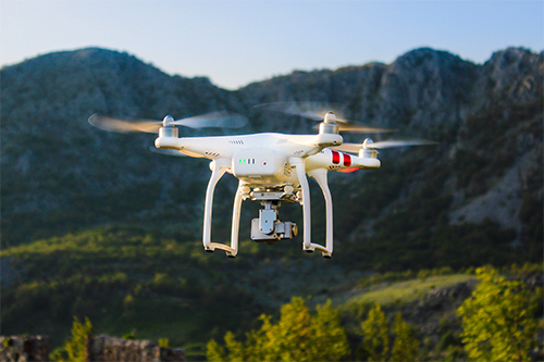 Kobe Insurance has both hands on the remote as drones lift off