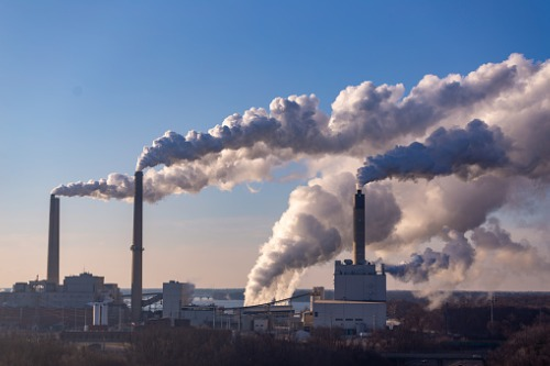 QBE, IAG join big banks in call for greenhouse gas cuts