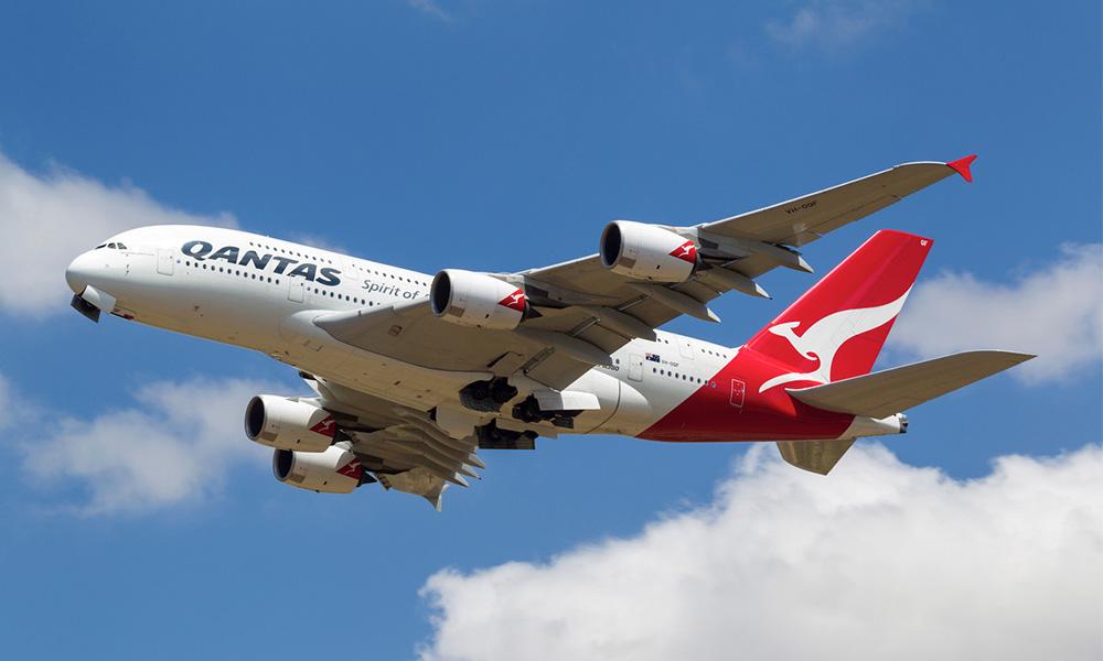 Qantas posts $1.08 billion half-year loss