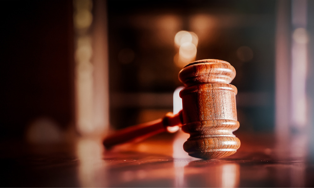 Employer sued over LGBTQ logo