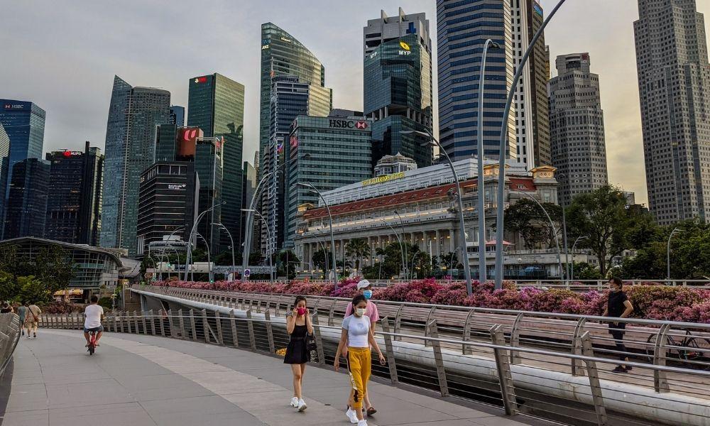 Singapore tightens COVID curbs, makes WFH 'default'