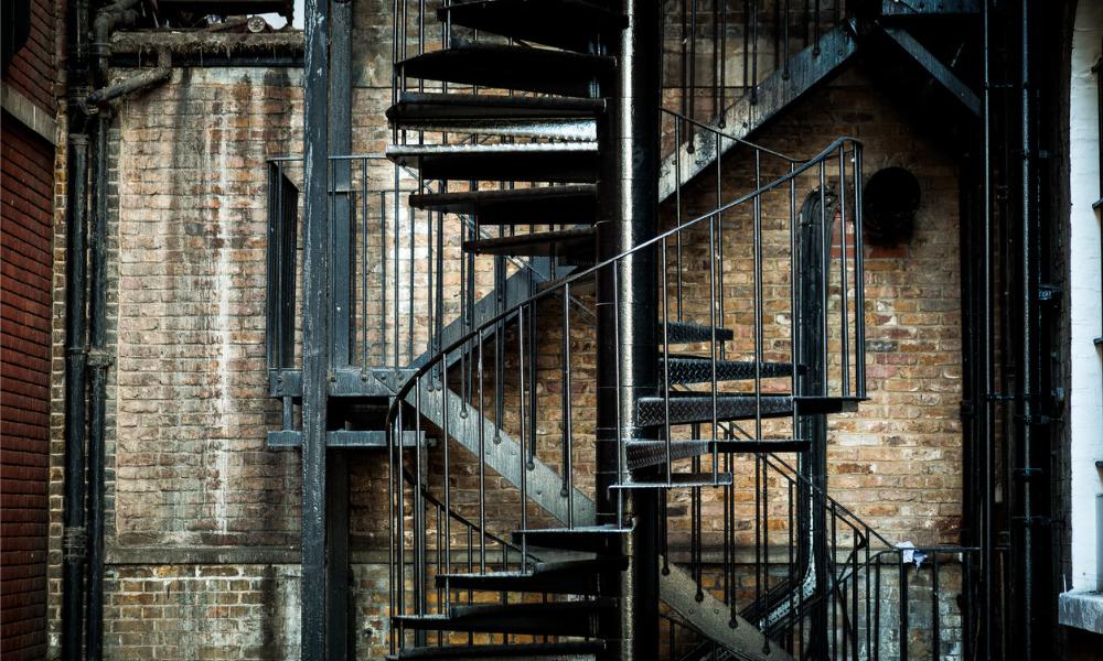 Worker dies after stairwell collapse